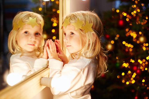 Preschooler Dressed as Angel Looking in Mirror