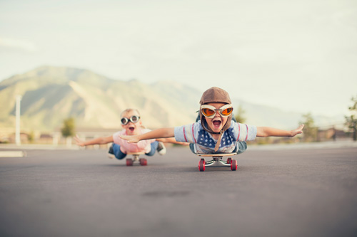 Children-Flying-Like-Ariplane-on-Skateboards