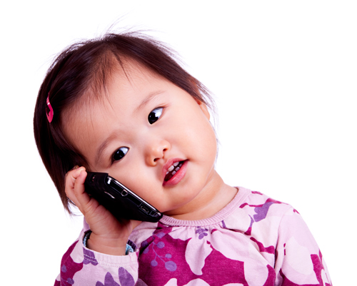 Older infant talking on phone.