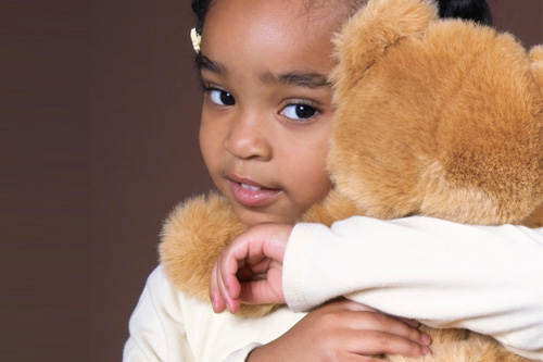 Child holding bear.
